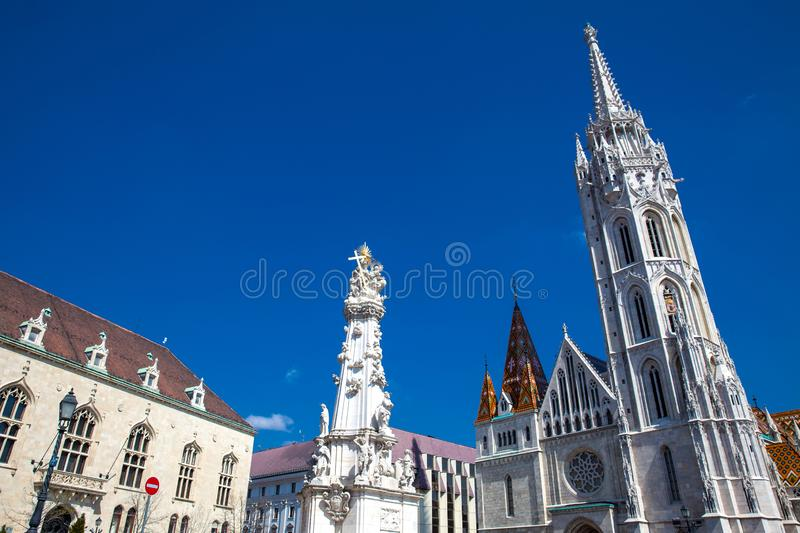 Matthias Church and the Statue of the Holy Trinity at Buda Castle District royalty free stock photos