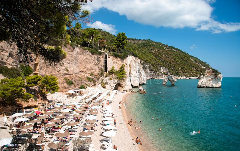 Mattinata Faraglioni stacks and beach coast of Baia Delle Zagare, Vieste Gargano, Apulia, Italy stock photography