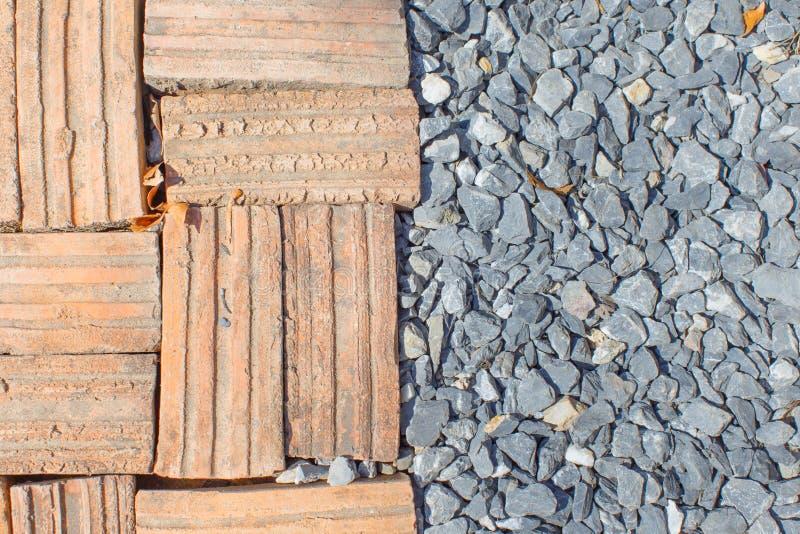 Mattone con il fondo di pietra del dettaglio della pavimentazione immagini stock