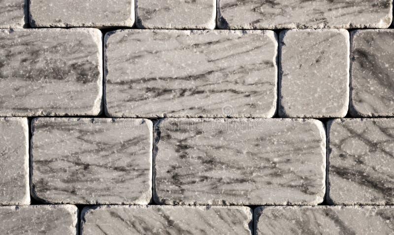 Mattone decorativo di struttura di marmo, mattonelle della parete fatte della pietra naturale Materiali da costruzione fotografia stock