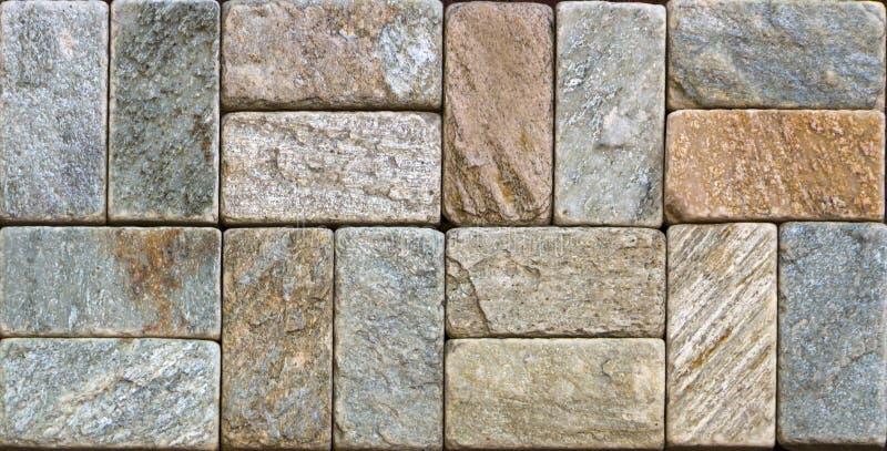 Mattone decorativo di struttura di marmo, mattonelle della parete fatte della pietra naturale Materiali da costruzione fotografia stock libera da diritti