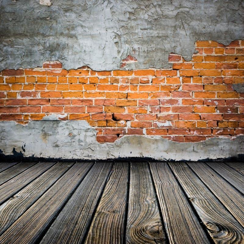 Mattone sbucciato dello stucco fotografia stock