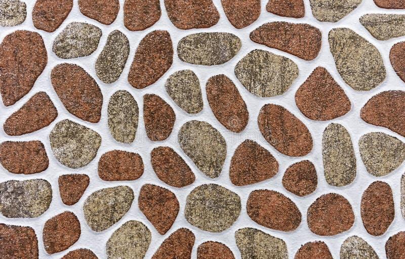 Mattonelle della porcellana con un modello delle pietre delle forme e delle dimensioni differenti Fondo delle pietre fotografia stock libera da diritti