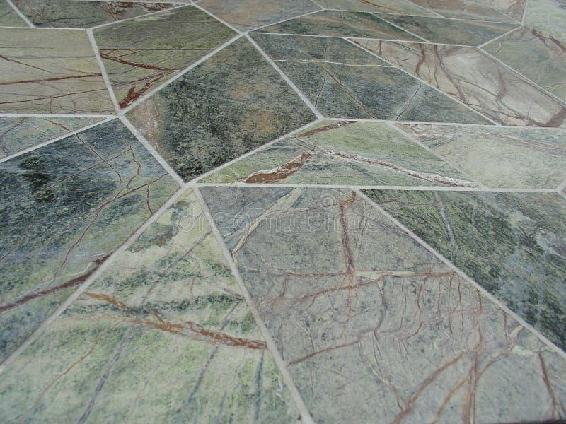 Mattonelle di pietra marmorizzate verdi di Geotile fotografia stock
