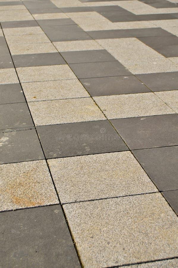 Mattonelle di struttura del granito del pavimento indossate immagine stock libera da diritti