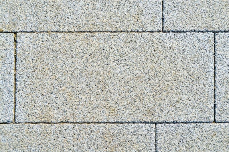 Mattonelle di struttura del granito del pavimento indossate fotografie stock libere da diritti