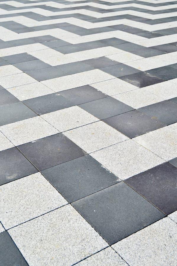 Mattonelle di struttura del granito del pavimento indossate Atrio, lucidato fotografia stock