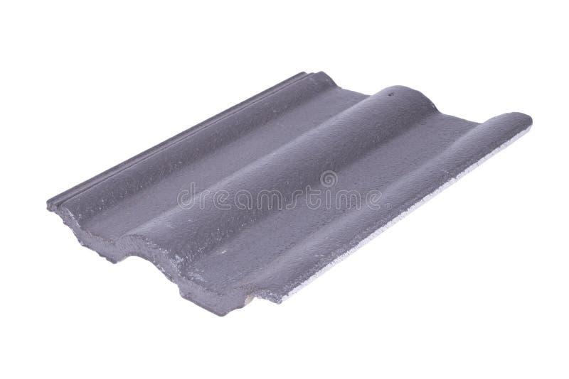 Mattonelle di tetto concrete (colore grigio) su bianco immagini stock