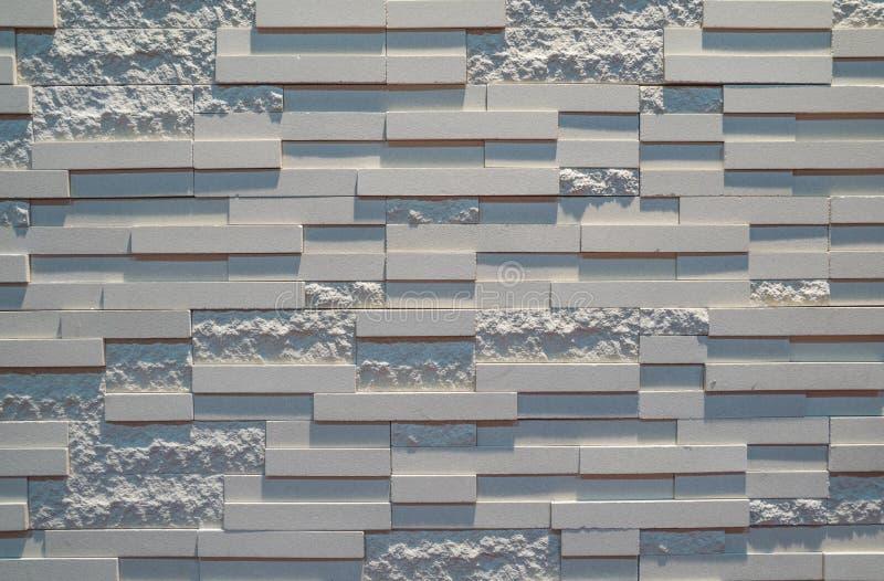 Mattonelle grige del granito della parete immagini stock