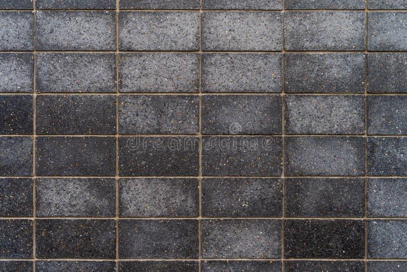 Mattonelle grigio scuro del granito con i modelli fini - struttura/fondo di alta qualità immagine stock libera da diritti