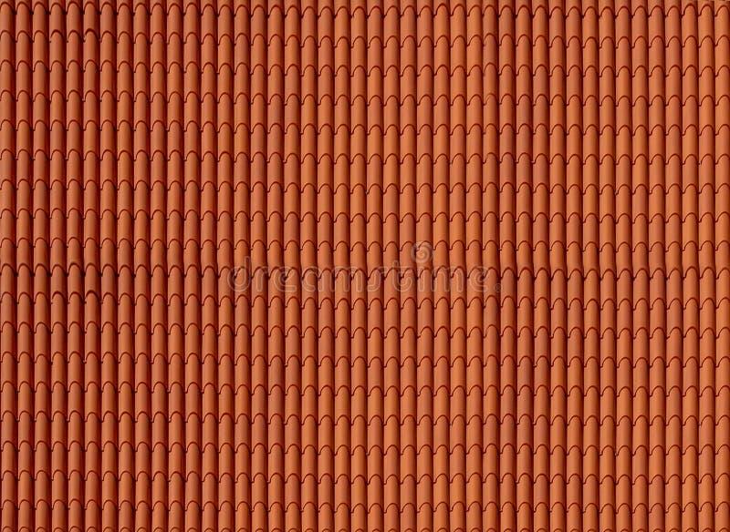 Mattonelle rosse materiali del tetto fotografia stock libera da diritti