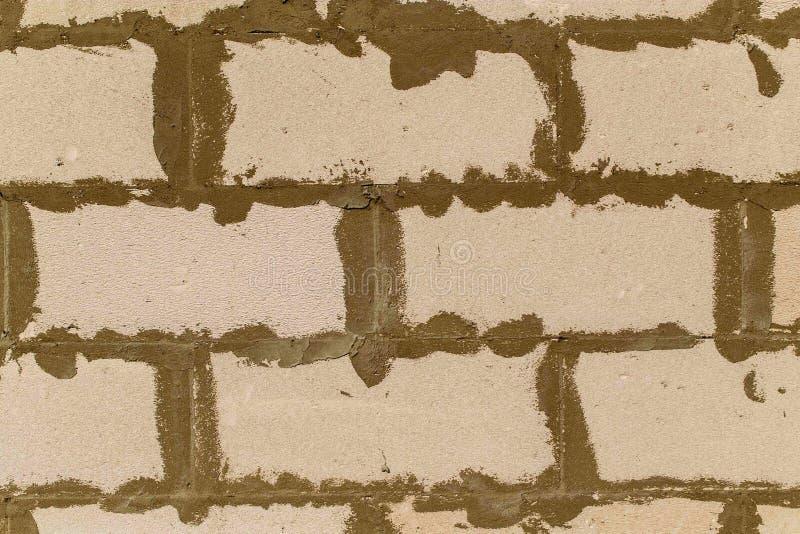 Mattoni del cemento cellulare nella parete come fondo astratto fotografia stock