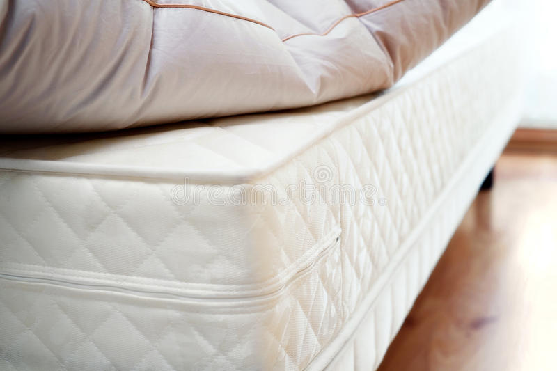 Mattress and pillow. Brand new white mattress and pillow on it. Ready for coating linens stock photos