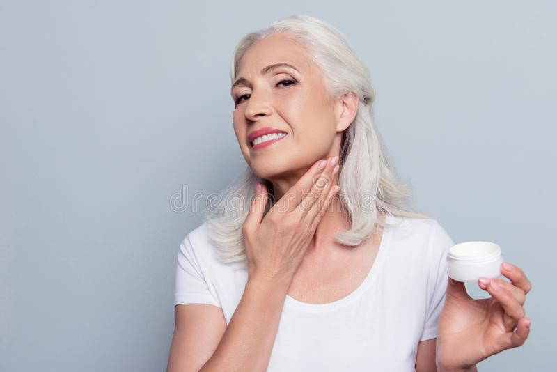 Mature adult senior woman with gray hair is taking care about he stock images