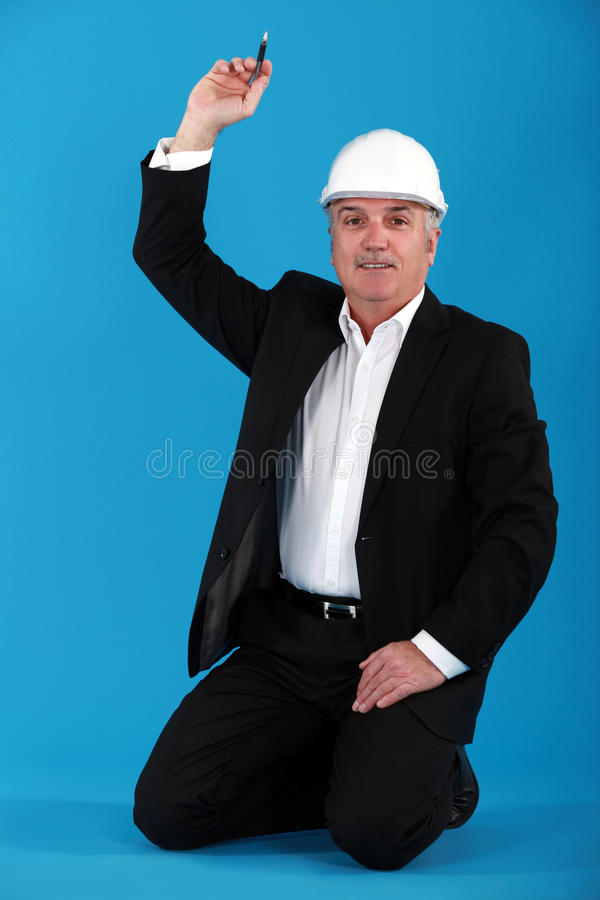 Mature Architect Kneeling Stock Images