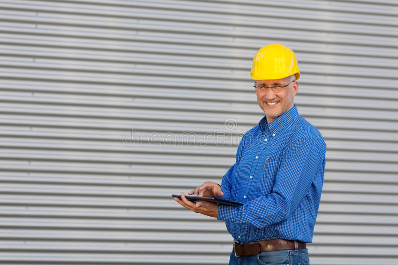 Mature Architect Using Digital Tablet stock photos
