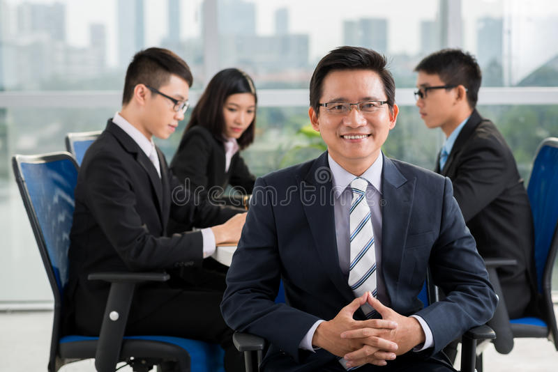 Mature Asian businessman royalty free stock image