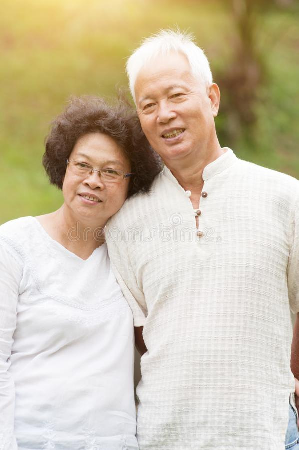 Mature Asian couple smiling outdoor. Happy elderly Asian seniors couple at outdoor park stock images