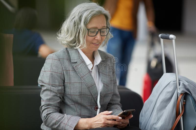 Mature Asian lady in airport stock photo
