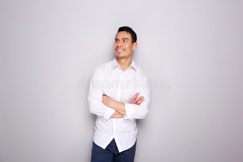 Mature asian man in casuals looking away and smiling royalty free stock images