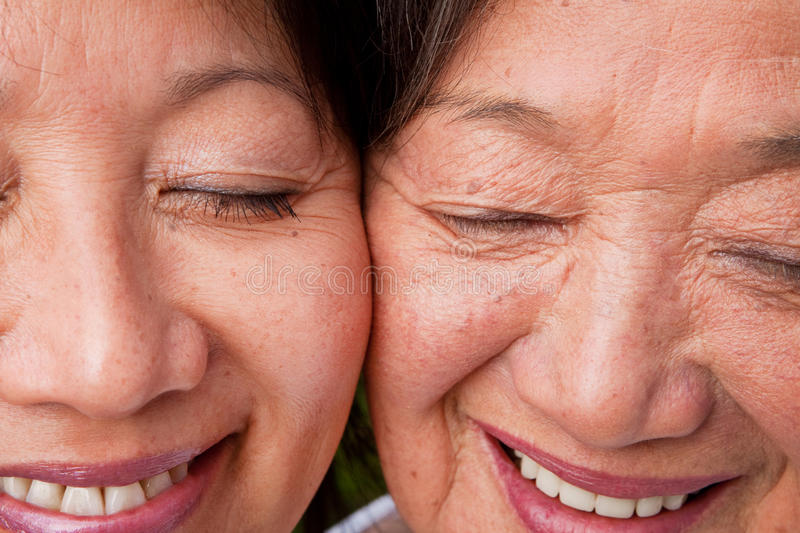 Mature Asian mother and her adult daughter. royalty free stock image