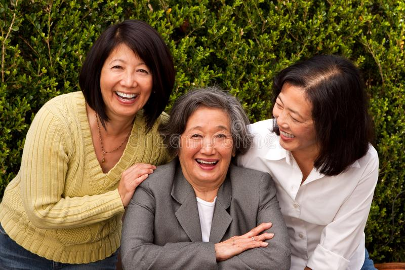 Mature Asian mother and her adult daughters. stock images