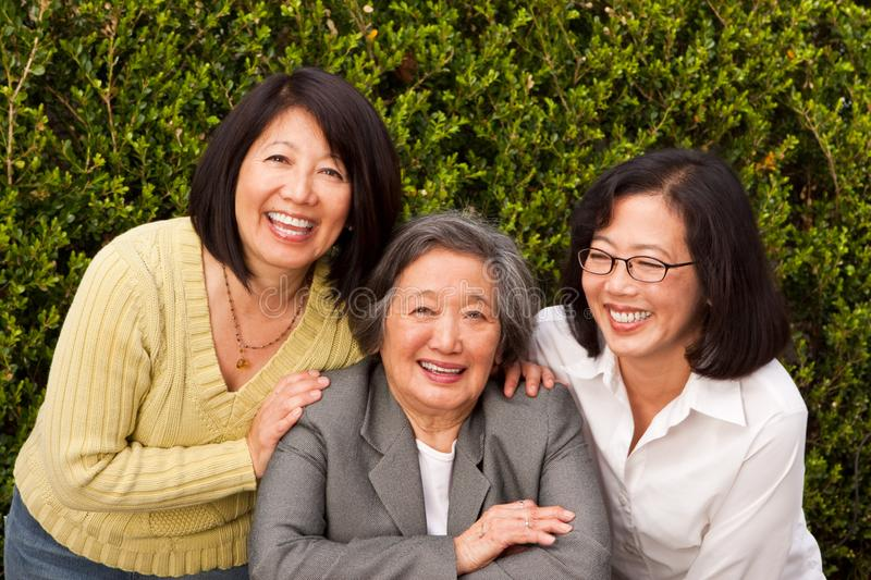 Mature Asian mother and her adult daughters. stock photography