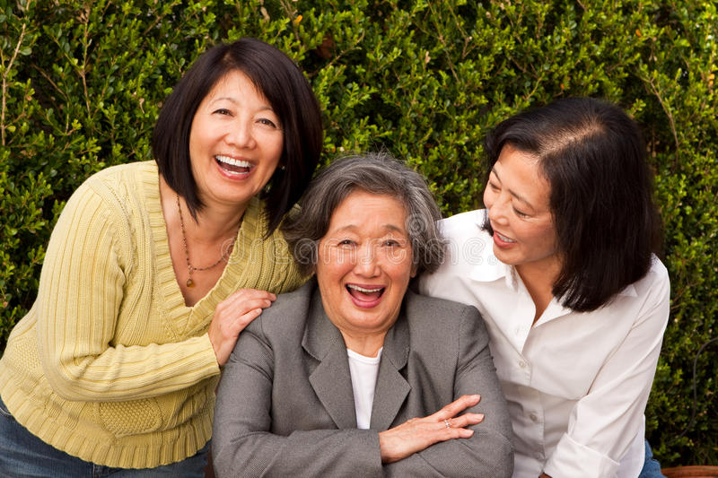 Mature Asian mother and her adult daughters. stock image