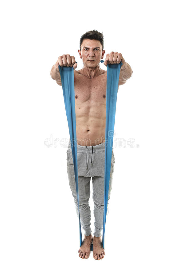 Mature athletic sport man with bodybuilder strong and fit body training doing exercises with elastic rubber band stock photos
