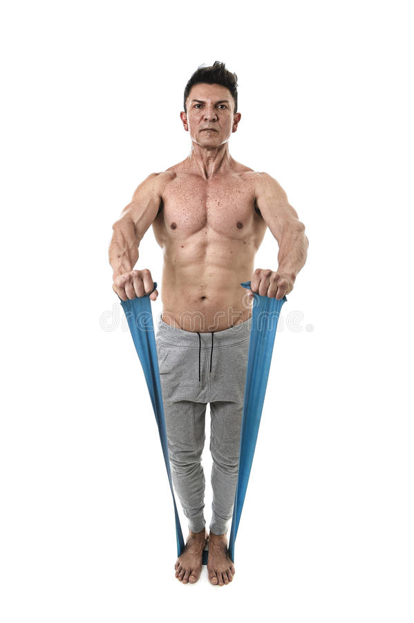 Mature athletic sport man with bodybuilder strong and fit body training doing exercises with elastic rubber band stock photo