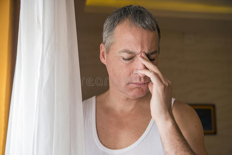 Mature attractive man looking worried, depressed, thoughtful and lonely suffering depression in work or personal problems royalty free stock images