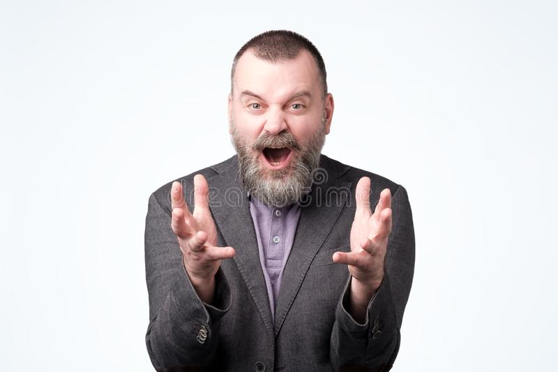 Mature bearded boss being dissatisfied demands explanation why he looses stock photo