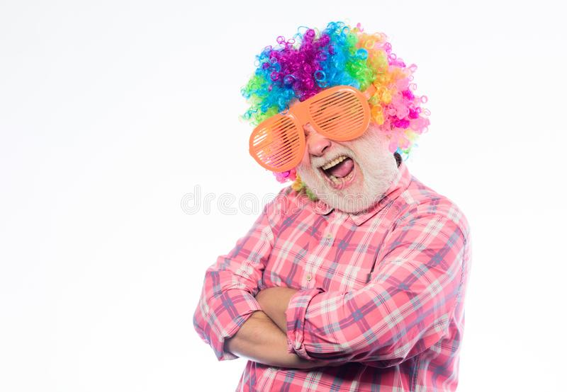 Mature bearded man in colorful wig and party glasses. Crazy man in playful mood. happy birthday. corporate party. Anniversary holiday. happy man with beard royalty free stock images