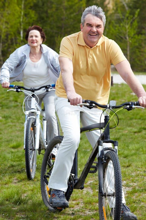 Mature bicyclist royalty free stock photos