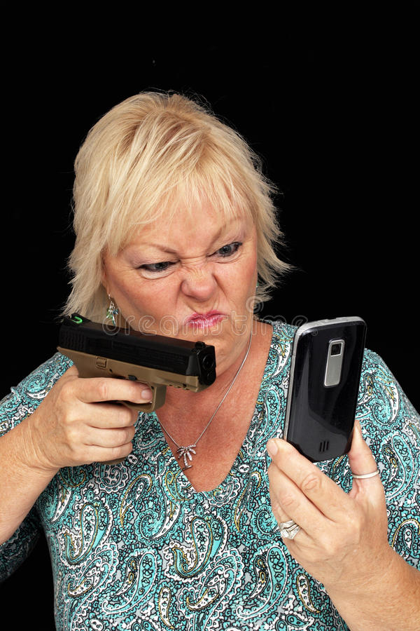 Download Mature Blonde With Cell Phone And A Handgun (1) Stock Photo - Image: 25271930