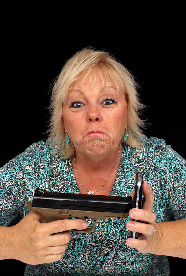 Mature Blonde with Cell Phone and a Handgun (4) royalty free stock images