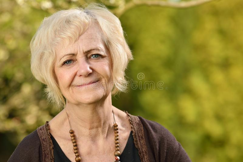 Mature, blonde woman. royalty free stock photography