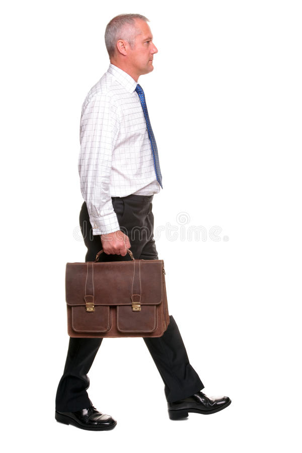 Mature businesman walking, side view. royalty free stock images
