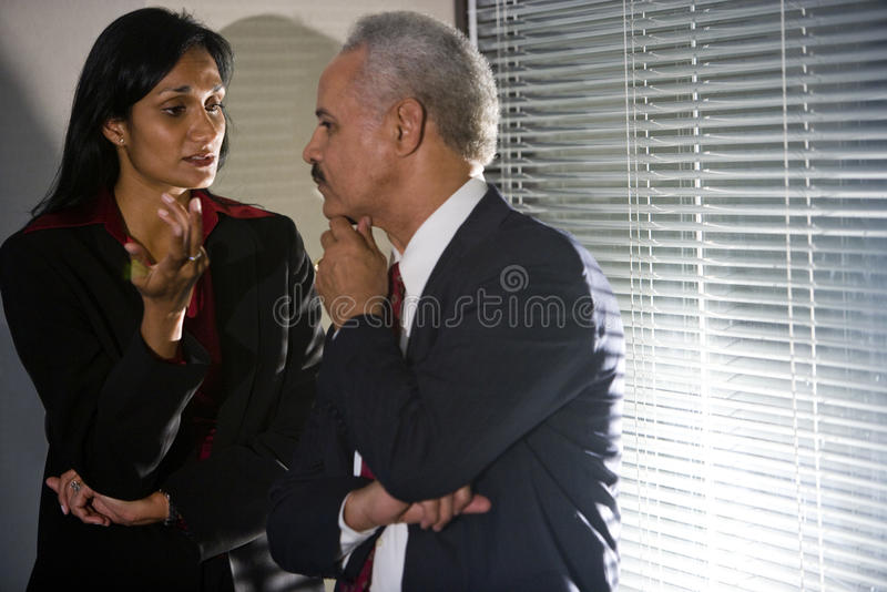 Mature business executives in private conversation stock photos