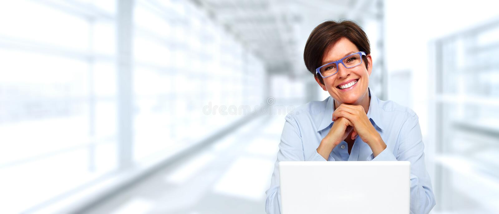 Mature business lady with laptop. royalty free stock photography