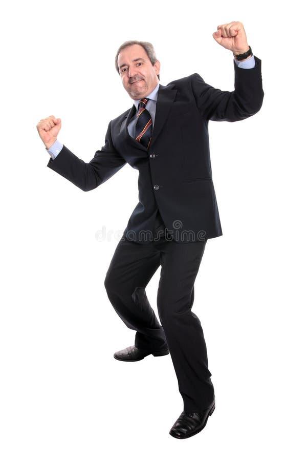 Mature business man cheering stock photos