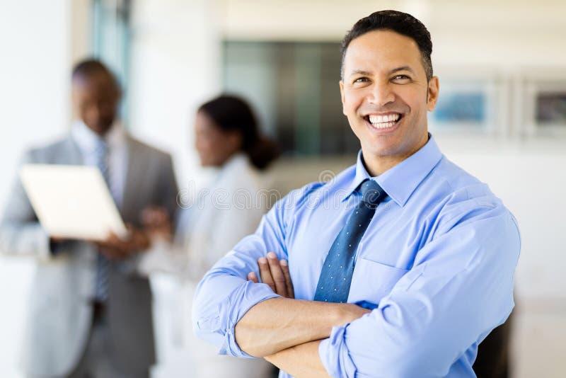 Mature business man office. Close up portrait of happy mature business man in office stock photo