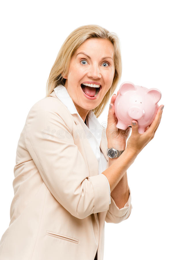Mature business woman holding piggy bank isolated on white background stock image