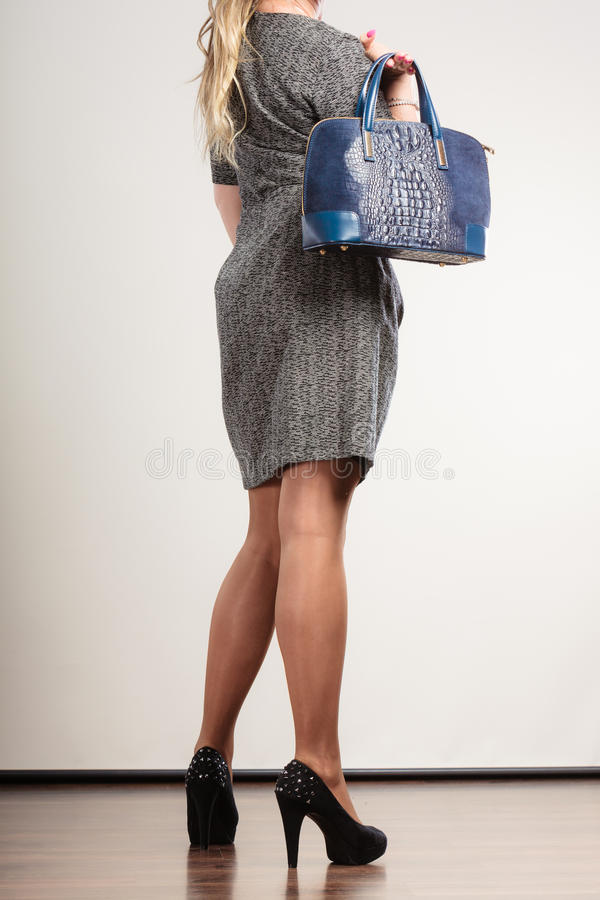Mature business woman holds handbag stock photo