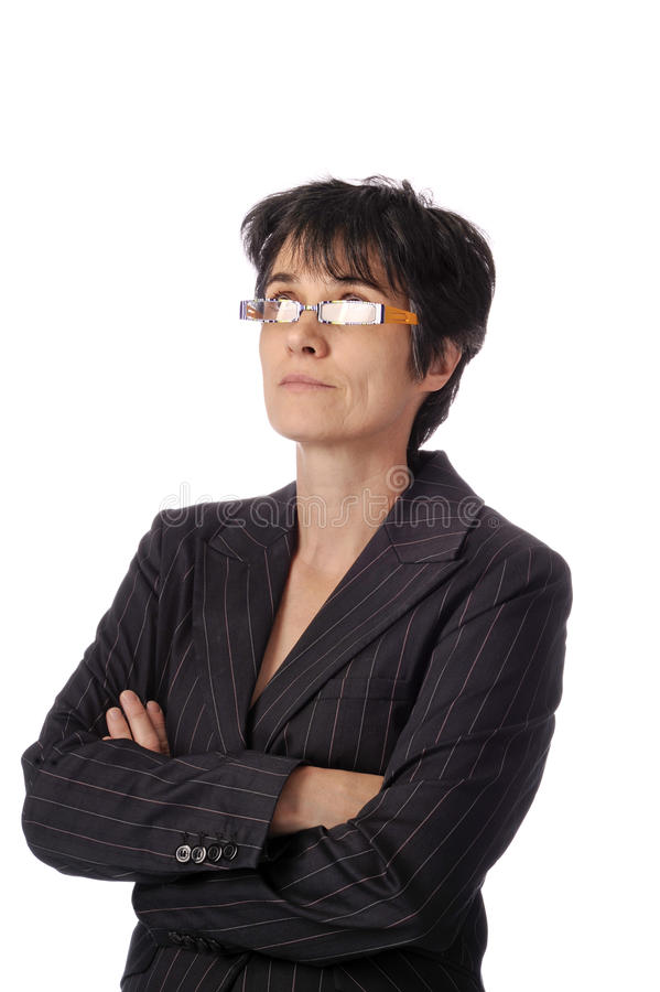 Download Mature Business Woman Looking Up Over Her Glasses Stock Photo - Image of vertical, wondering: 19945812