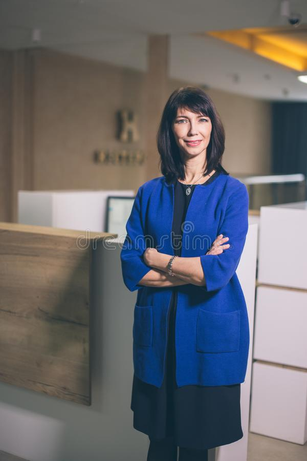 Businesswoman Standing in modern office stock photography