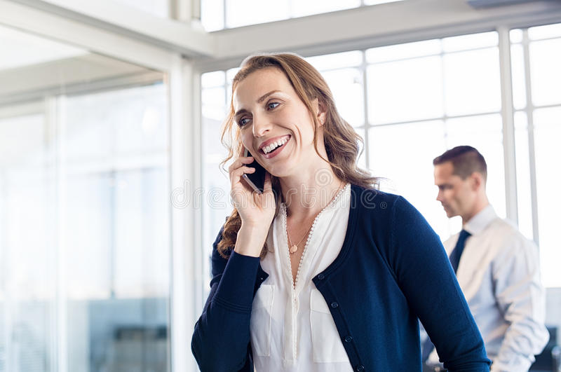 Businesswoman talking over phone stock images