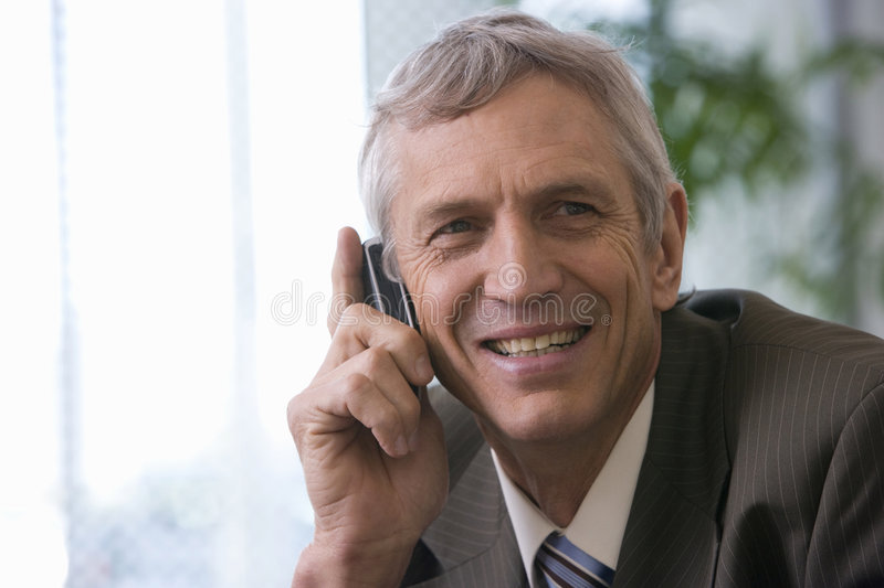 Mature businessman on cellphone royalty free stock images