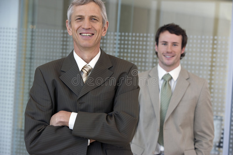 Mature businessman with collea stock image