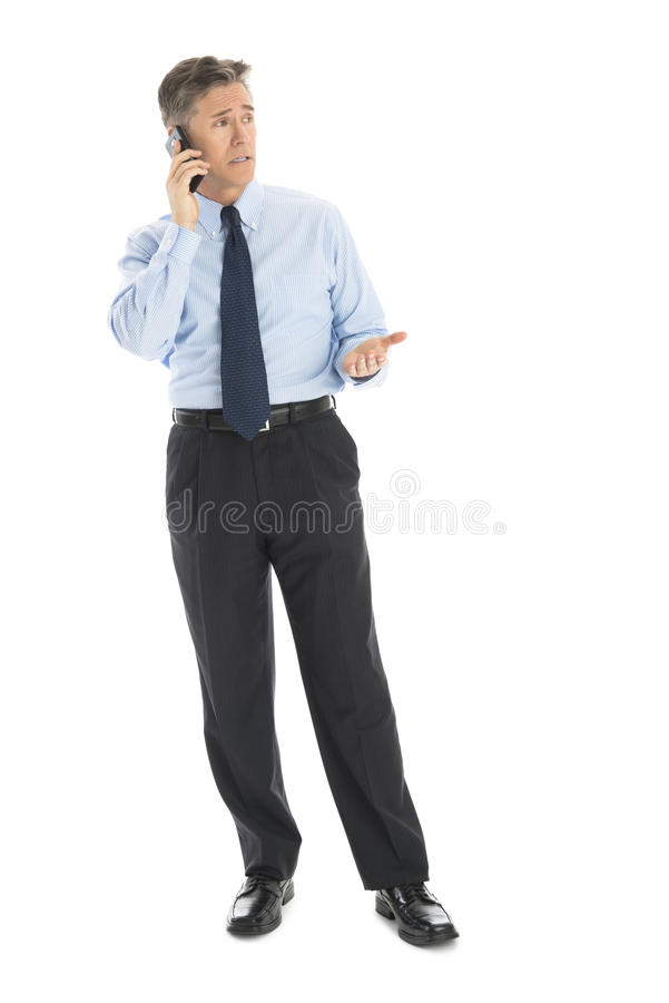Download Mature Businessman Gesturing While Using Smart Phone Stock Image - Image: 32062045